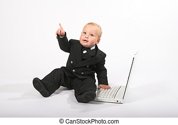 baby executive 10 - Young child in suit working on a laptop...