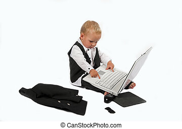 baby sales executive - Young child in suit working on a...