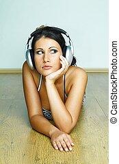 Listen to Music - Young beautiful happy women listening...