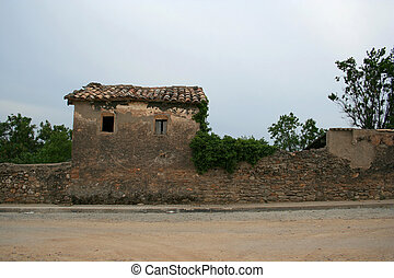 olde spanish house - shot of a house left derelict on a...