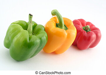 green yellow and red peppers on a white background