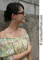 Side profile of a woman wearing big shades - Portrait of a...