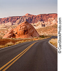 Flexibility - A winding desert road travels around an...