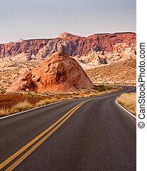 Flexibility - A winding desert road travels around an...