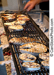 fresh fish cooking - fresh fish on the grill in the greek...