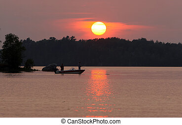Fishermen at sunset - Two men fishing on a remote Wisconsin...