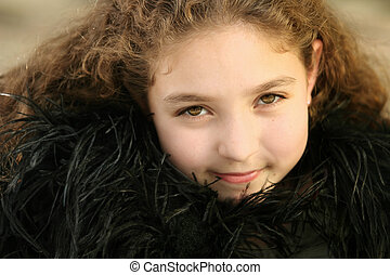Cute girl in black feathers