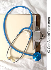 Stethoscope 5 - Stethoscope on clipboard and scrubs