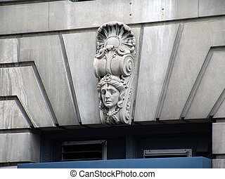Carved Face of woman on building