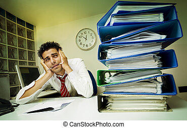 monkey business - exhausted businessman surrounded by files