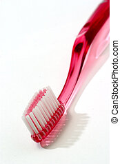 Toothbrushes04 - Pink toothbrush isolated against white