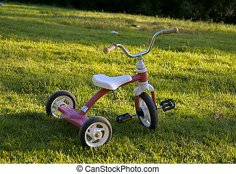 tricycle - Children  tricycle on the grass