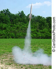 Blast Off - a model rocket taking off
