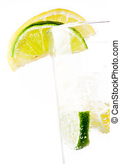Glass of 7up with lemon and lime isolated on white...