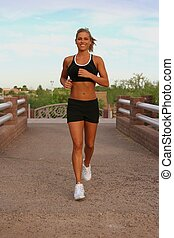 Woman running - Woman jogging in a park