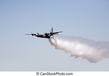 fire fighting aircraft - hercules C130 releases its load of...