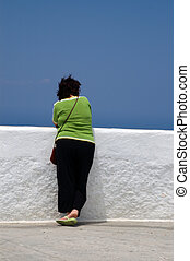 woman thinking - woman at scenic overlook white wall