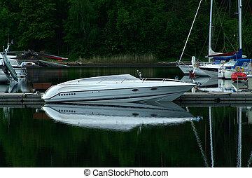 Speedboat - White speedboat at a pier