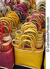 Shopping Bags - Woven shopping bags on display in a French...