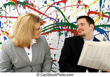 Business Associates - Professional woman and man with...