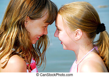 Two girlfriends - Portrait of two young happy girls