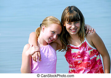 Two preteen girls - Portrait of two preteen girls standing...