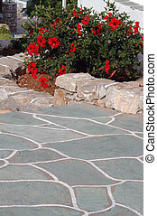 stone walkway with flowers - typical stone walkway and walls...