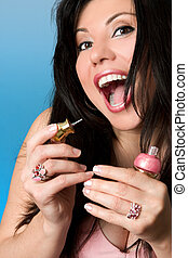 Beauty - woman with pink nailpolish - Vibrant woman with a...