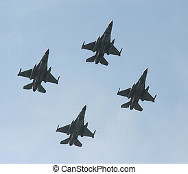 jet fighters - A formation of 4 F-16 jet fighters