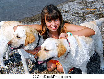 Girl two dogs - Portrait of a young pretty girl with two...