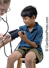 Young child having an examination - Young asian boy examined...