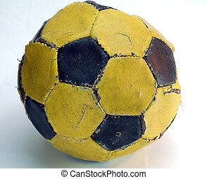 worn-out football at the end of the rood ready to been...