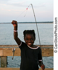 Fishing - A little girl and her fish.