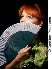 prayer - pretty redhead with green fan