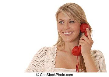Lovely girl talking on standard telephone