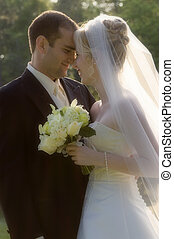 Hearts and noses touching - Beautiful and handsome bride and...