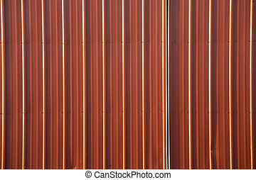 Stock Photo of a Corrugated Metal Red Background - A...