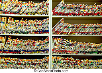 Medical files with patient information in doctors office