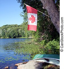 Canadian Flag - A Canadian Flag Flying over a Lake