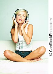 Listen to the music - Young beautiful happy women listening...