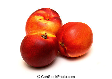 Nectarines - three nectarines isolated on a white background