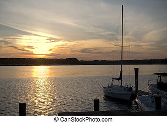 Sailboat Sunset - The sunsets over a bay along the Jersey...