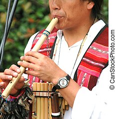 Bamboo Flute - Musician playing a bamboo flute.