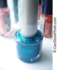 Blue nail polish - Bottle of blue nail polish on white table...