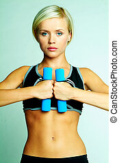 Fitness - Young beautiful woman during fitness time and...