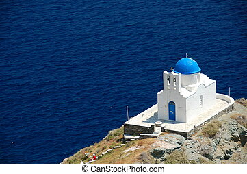 greek chapel - lovely greek chapel by the sea on rocky...