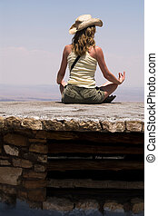 Meditation looking over the Grand Canyon - woman in straw...