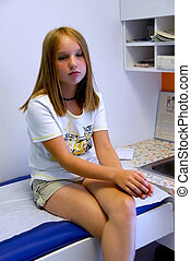 Girl doctor office - Young girl waiting in doctors office...