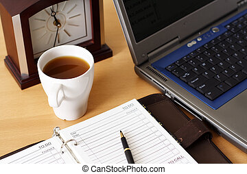 Office environment - Planning on a business organizer at...