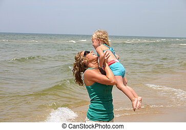 mother and daughter - a day at the beach